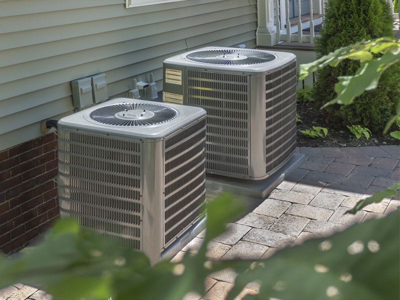 Two central air units outside a home | Purchasing the Right Air Conditioner | Sacramento, CA | Purchasing Right Air Conditioner