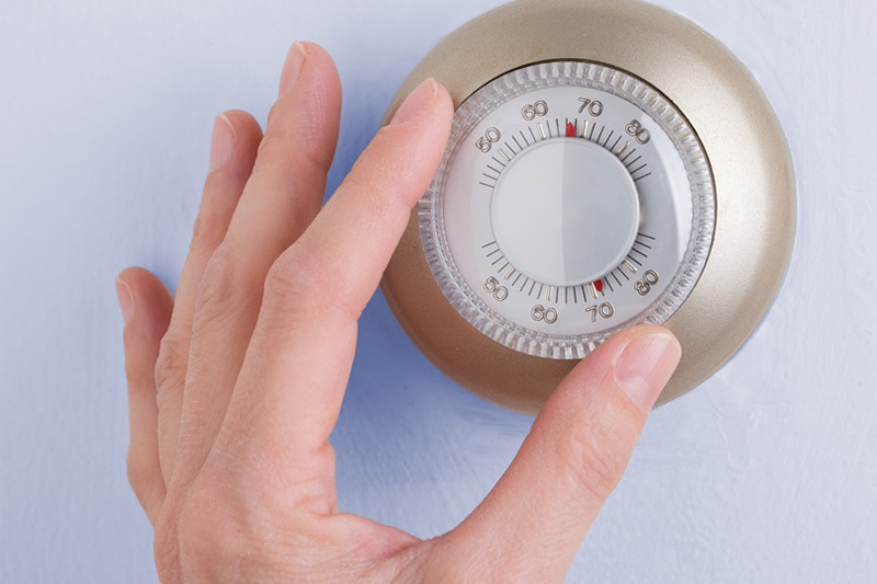 what is short cycling?, hand adjusting thermostat