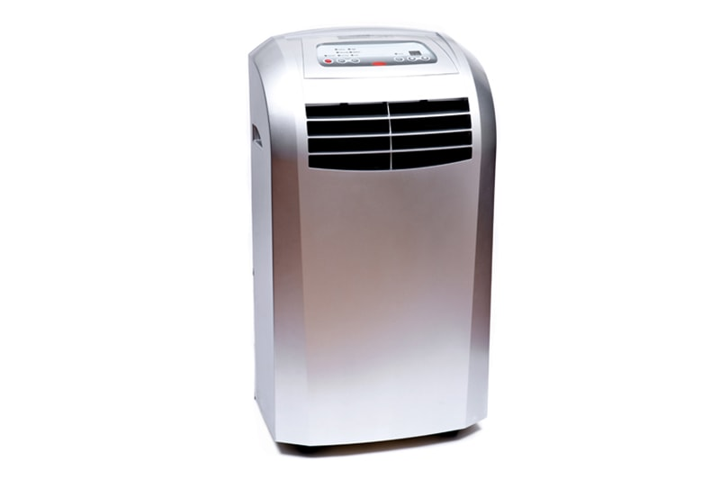 Medium room portable single hose home dehumidifier air conditioner with window mounting kit isolated on white background