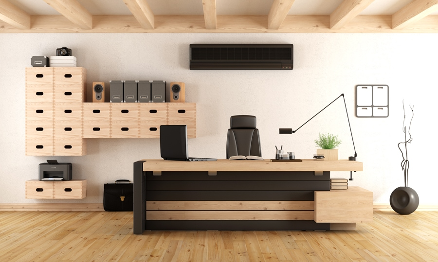Wooden office with a black ductless air conditioning unit.